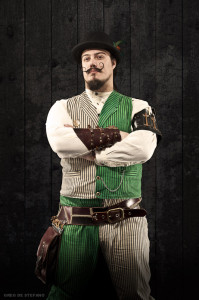 Man with a mustache in a steampunk costume.
